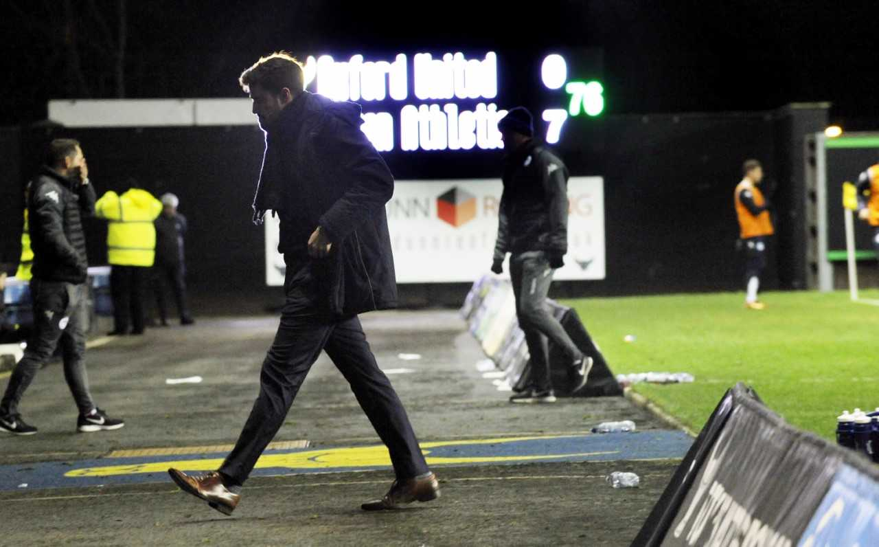 The scoreboard says it all as Oxford United manager Pep Clotet walks back to the bench  Picture: David Fleming