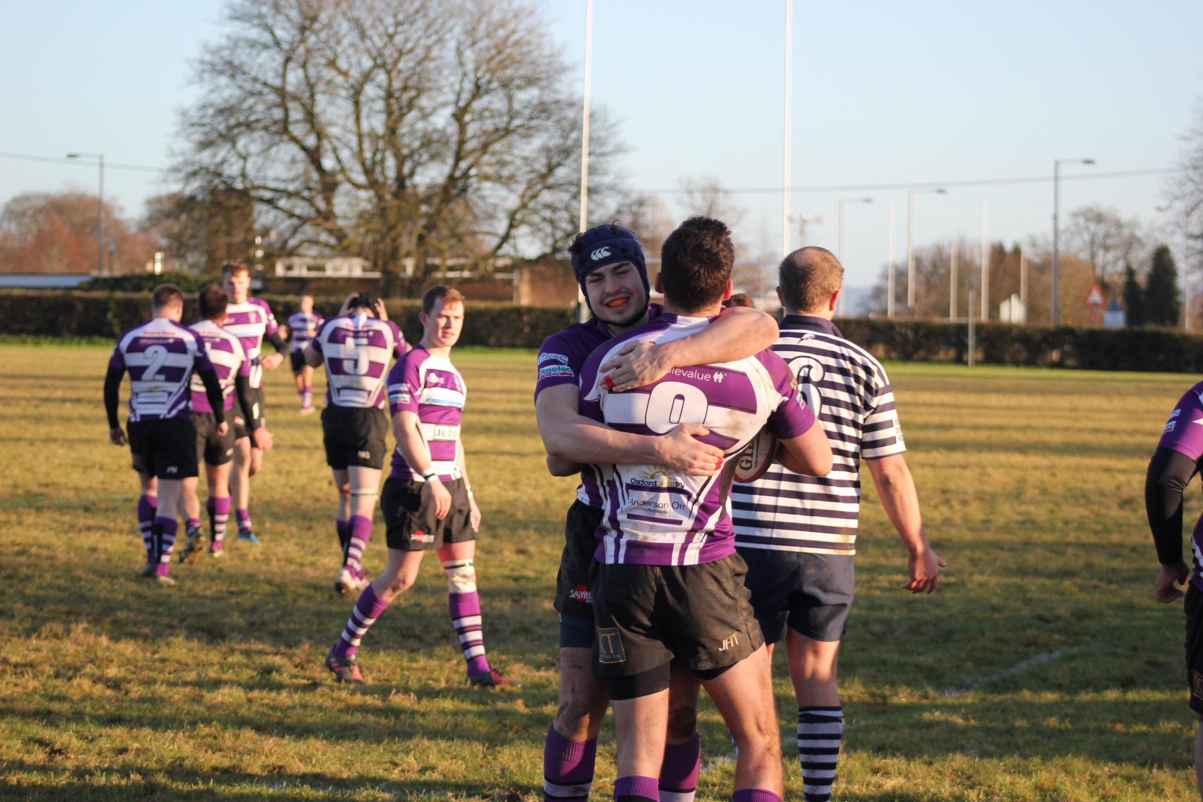 Caillin Taylor congratulates Jack Taylor on his try during Wheatley's victory over the Blue Boar in the Oxfordshire Shield Picture: Simon Chadbone