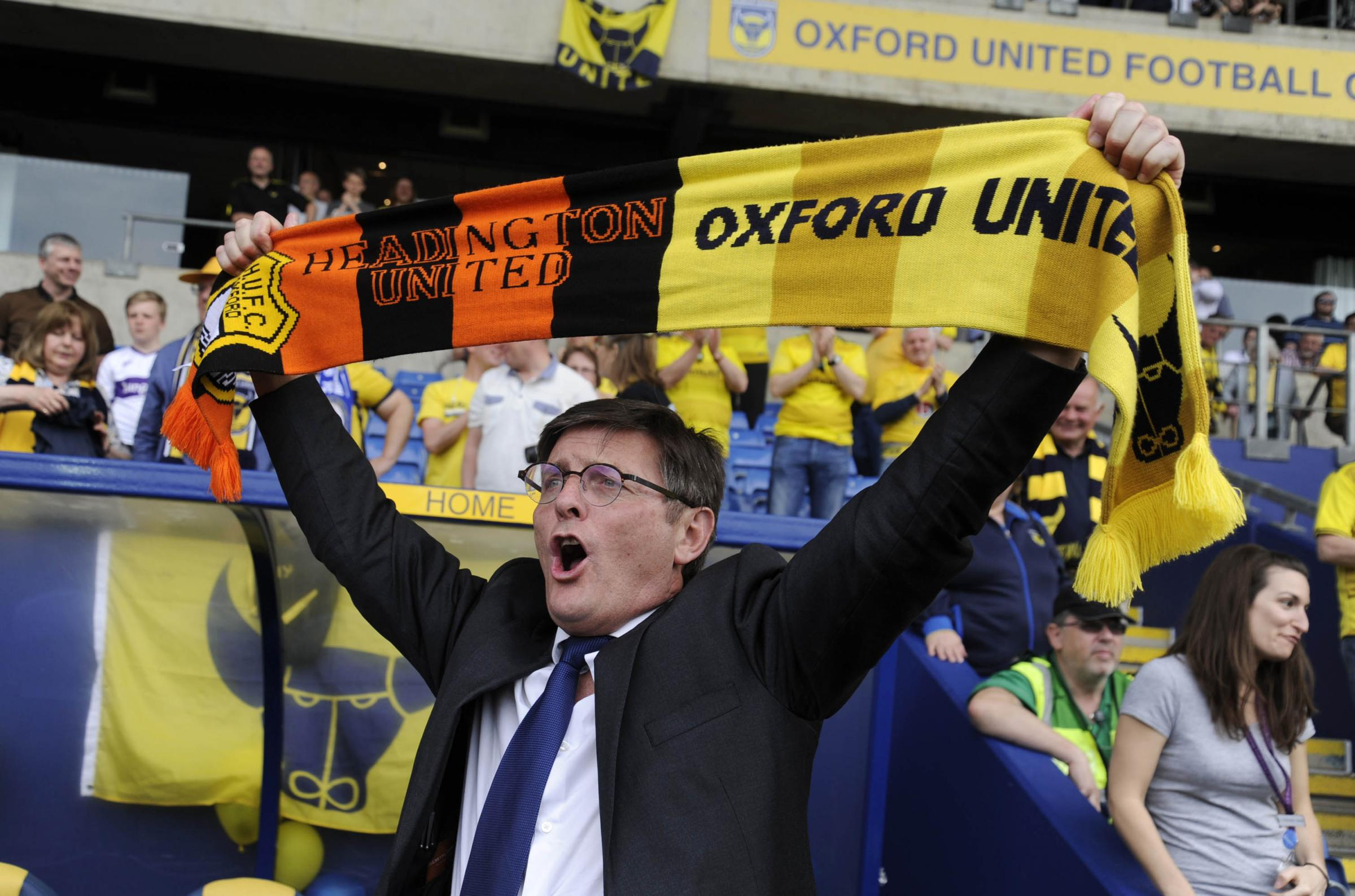 Darryl Eales celebrates Oxford United's promotion to Sky Bet League One in 2016