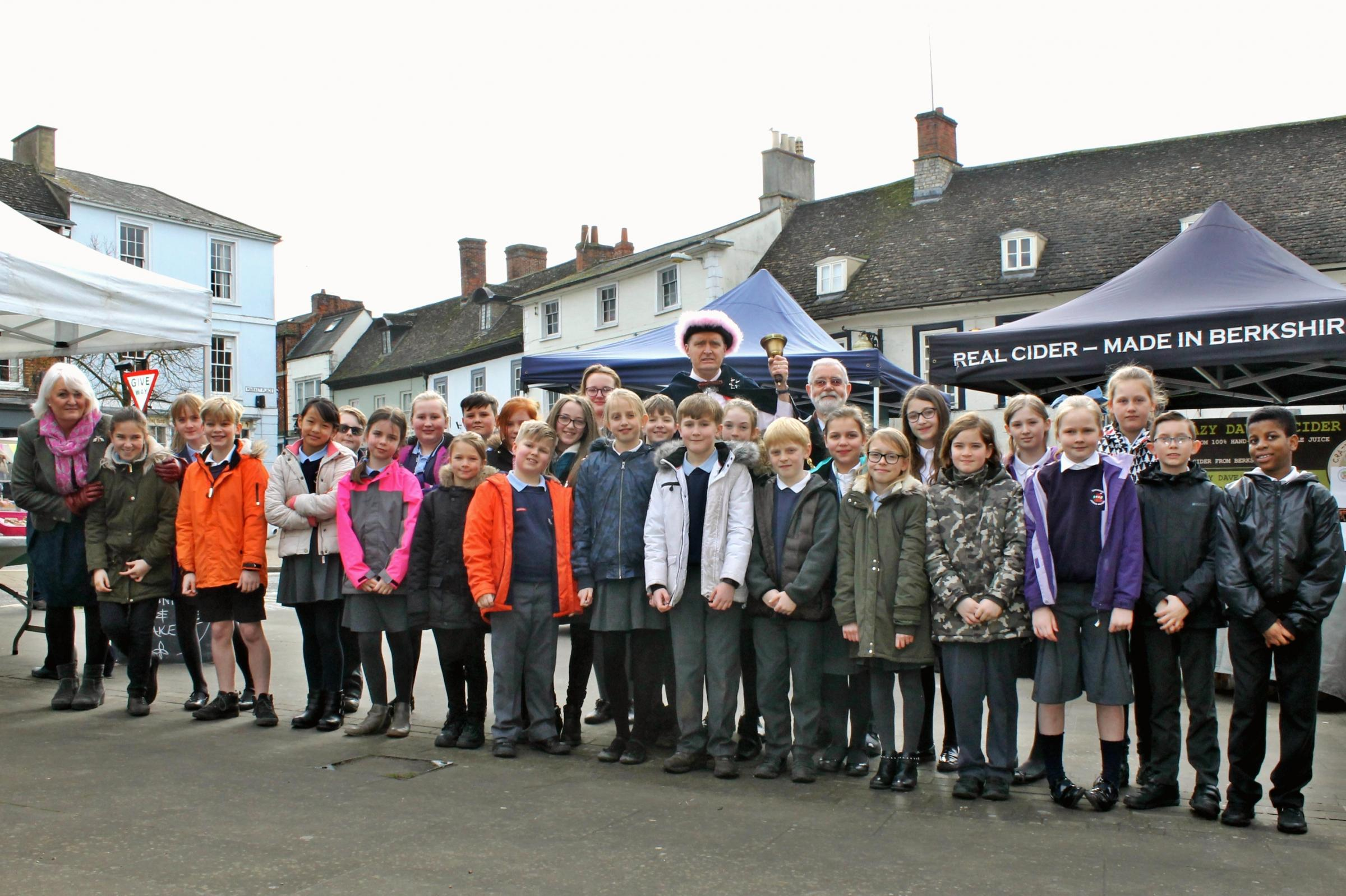 Children from Faringdon Junior School with town crier Sjoerd Vogt and Mayor of Faringdon Mike Wise celebrating the town's 800th anniversary market on Tuesday, March 6, 2018. Picture: Faringdon Town Council