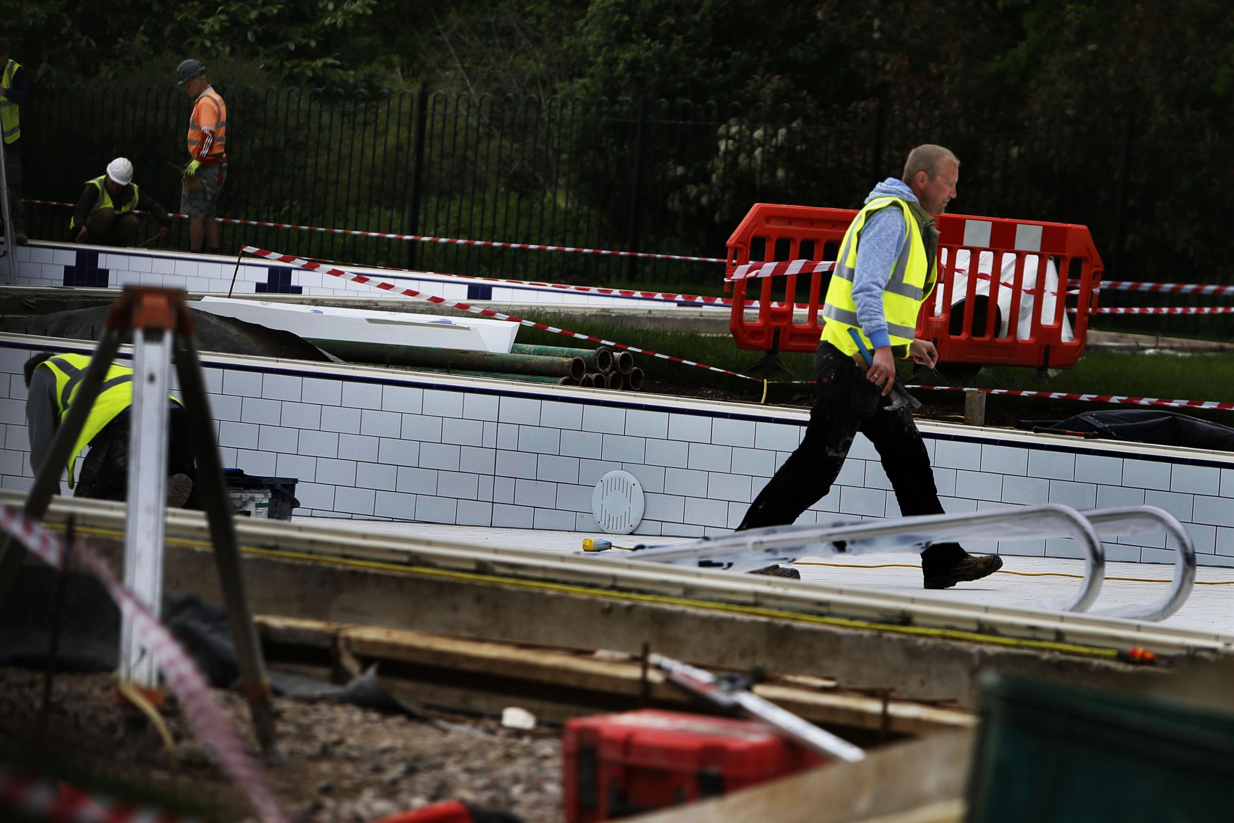FINAL PREPARATIONS: Workers busy at the Abbey Meadow pool Picture: Ed Nix