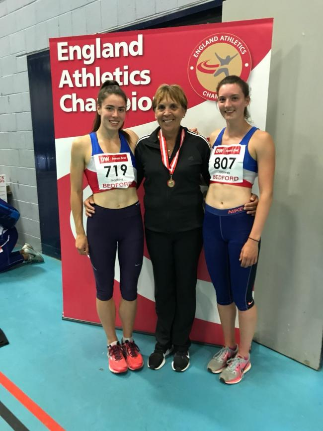 WINNING SMILES: Under 23 long jump champion Alice Hopkins (left) and Under 20 winner Jade O'Dowda (right) with their Oxford City coach Marcia Marriott