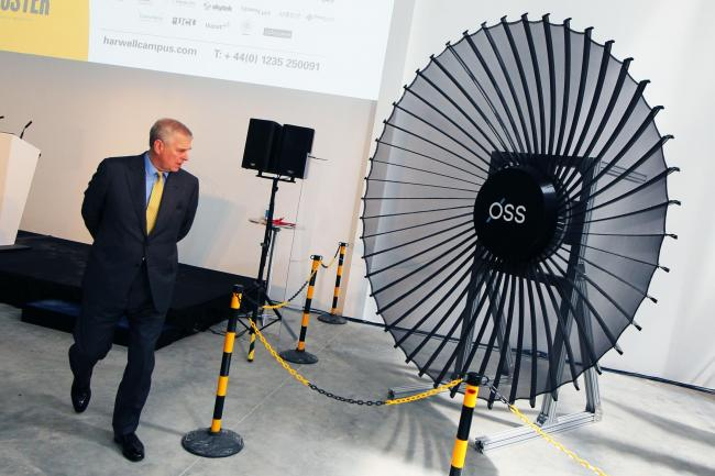 Prince Andrew examines Oxford Space Systems technology at Harwell Oxford. Pic Ed Nix