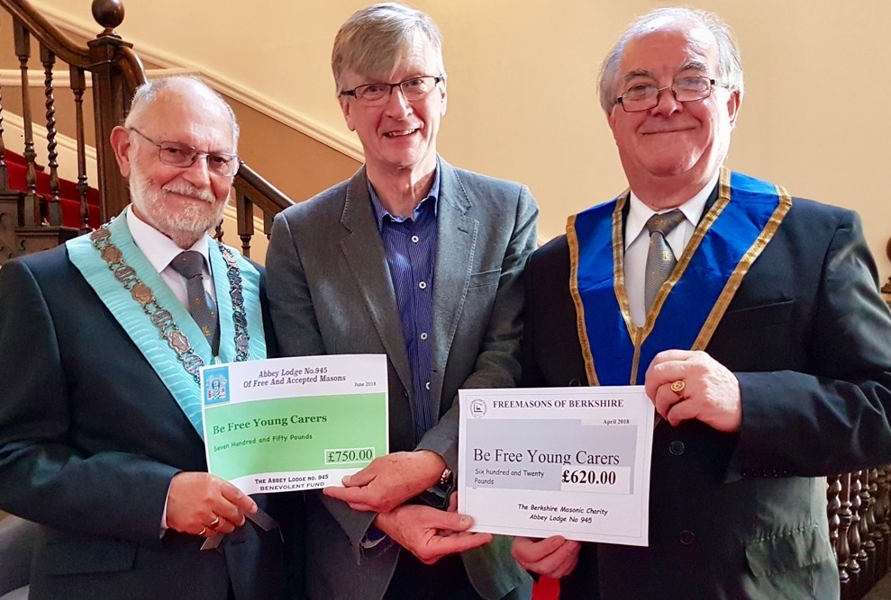 John Tabor (pictured middle) receiving two cheques from Brian Page (pictured left) and Ken Jones (pictured right) of Abbey Lodge, Freemasons, Abingdon.