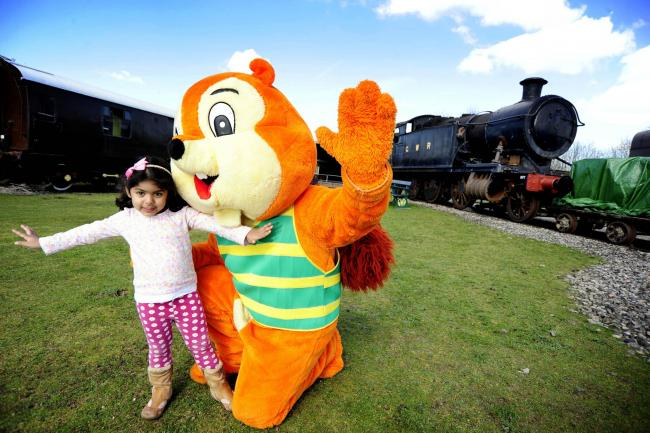 All creatures great and small: Chipper the mascot from the Tree House Play Centre meets Arianna Janjuha at an Easter fun day at Didcot Railway Centre. Picture: David Fleming
