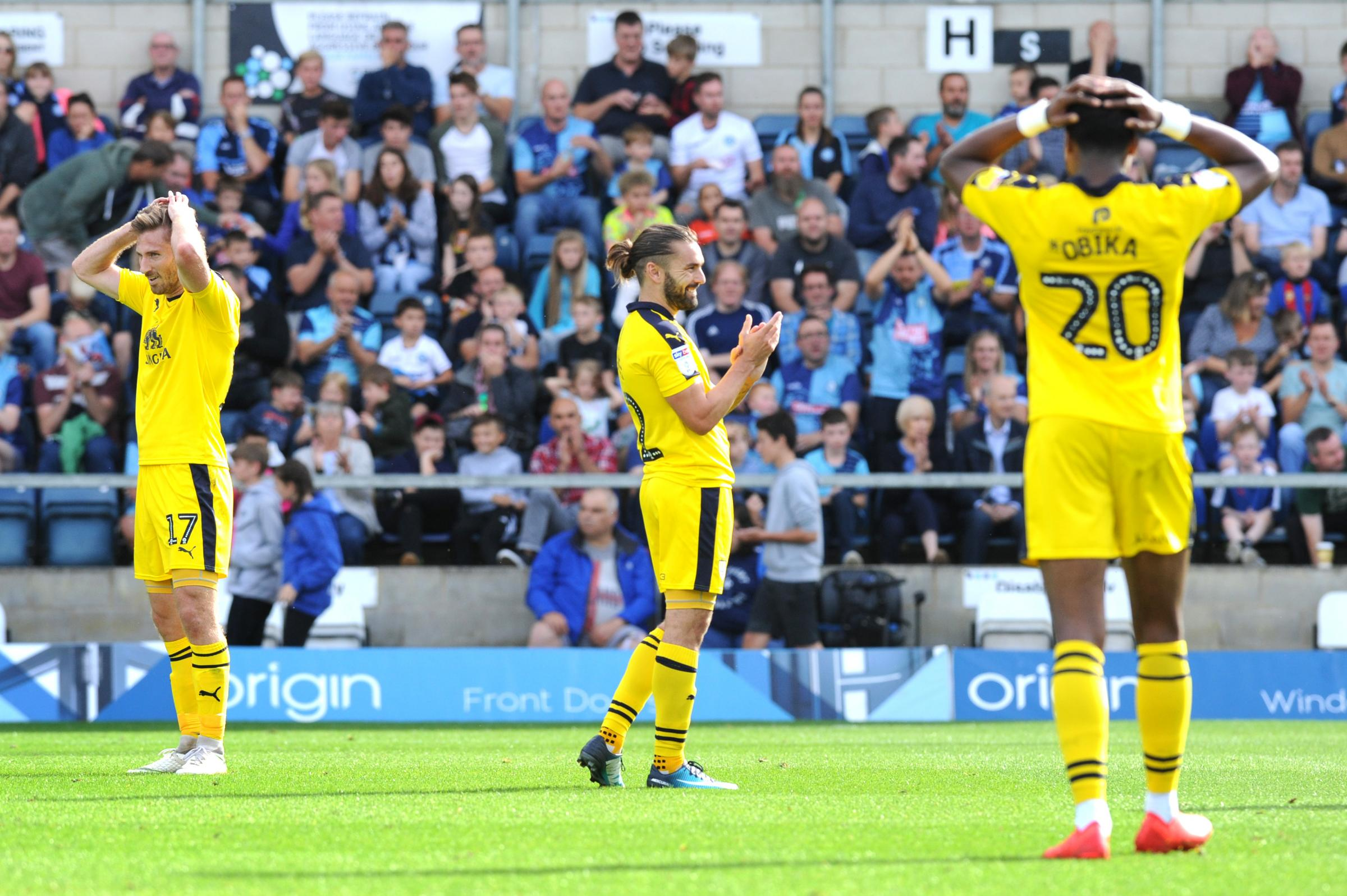 NEAR MISS: James Henry, Ricky Holmes and Jon Obika cannot believe it as another Oxford United chance goes beggingPicture: Jon Lewis
