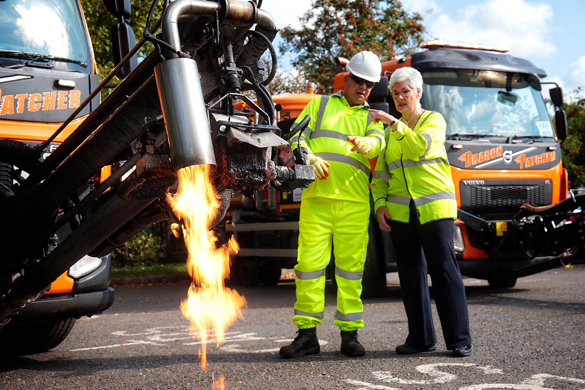 Engineer Tim Harris and cabinet member for environment Yvonne Constance with a Dragon Patcher, which the council uses for some road repairs