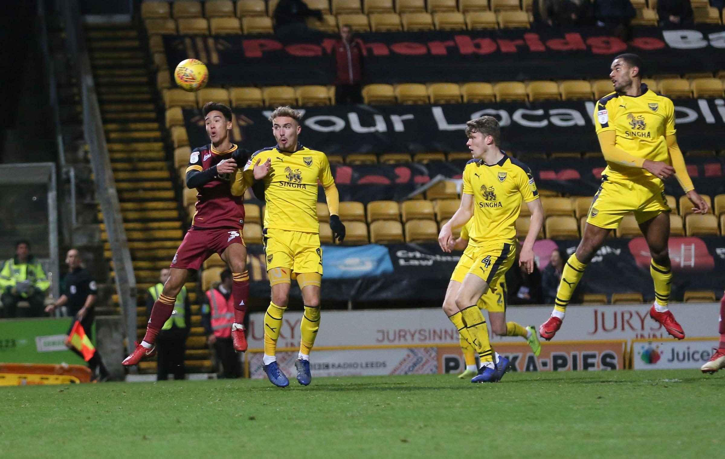 Curtis Nelson heads towards goal in injury time but his effort hit a post during Oxford United's defeat at Bradford City Picture: Richard Parkes
