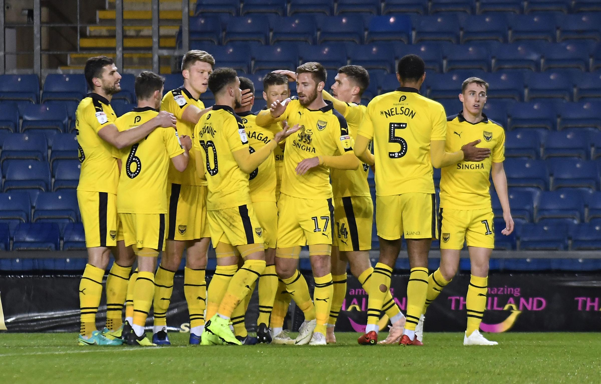 Oxford United's players celebrate Jamie Mackie's opener against Rochdale Picture: David Fleming