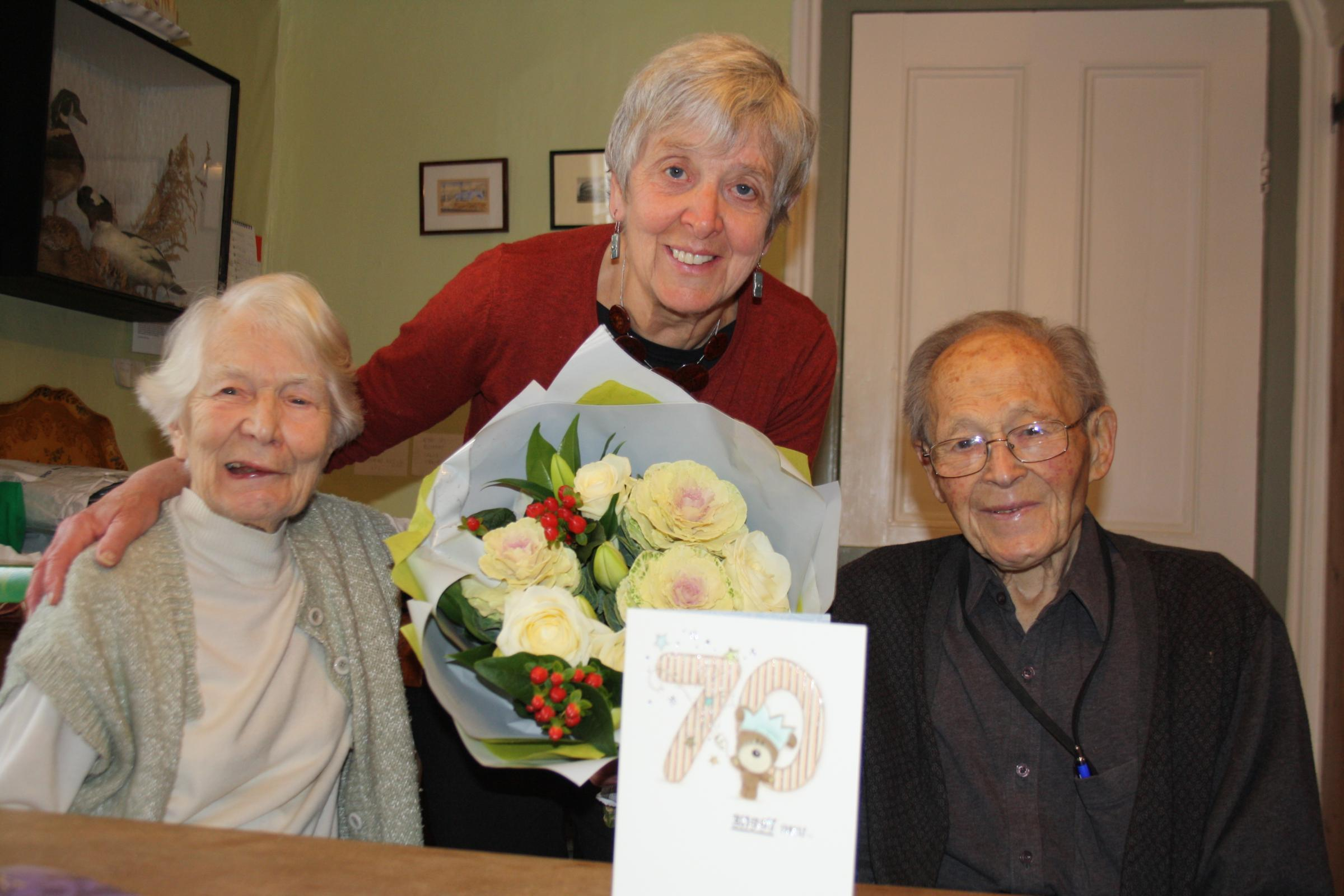 Care giver Liz Race with Eleanor, 90, and Ken Fuller, 95, at their home in Wallingford