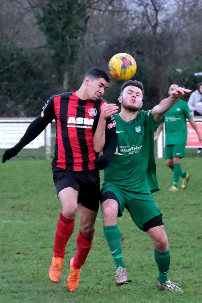 Thame United's Lynton Goss (left) battles with Kidlington's Josh Tooke during the New Year's Day derby Picture: Ric Mellis