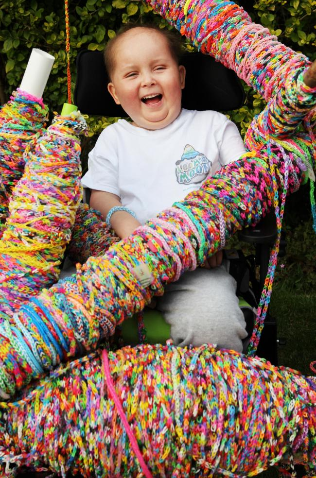 Skye Hall pictured with some of the thousands of loom bands he collected for his Loom to the Moon campaign.