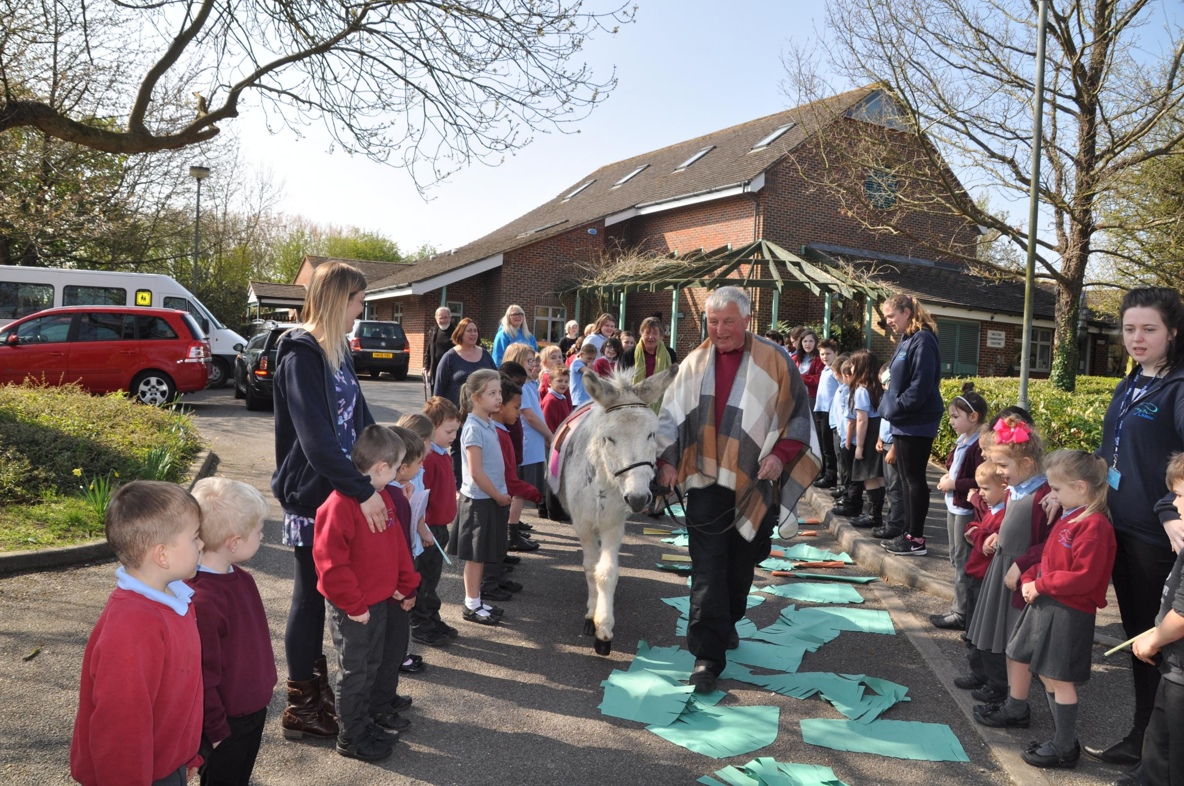 St Blaise Primary School celebrate Palm Sunday 2017 with a donkey from the Donkey Sanctuary in Brightwell-cum-Sotwell. Picture: St Blaise Primary School