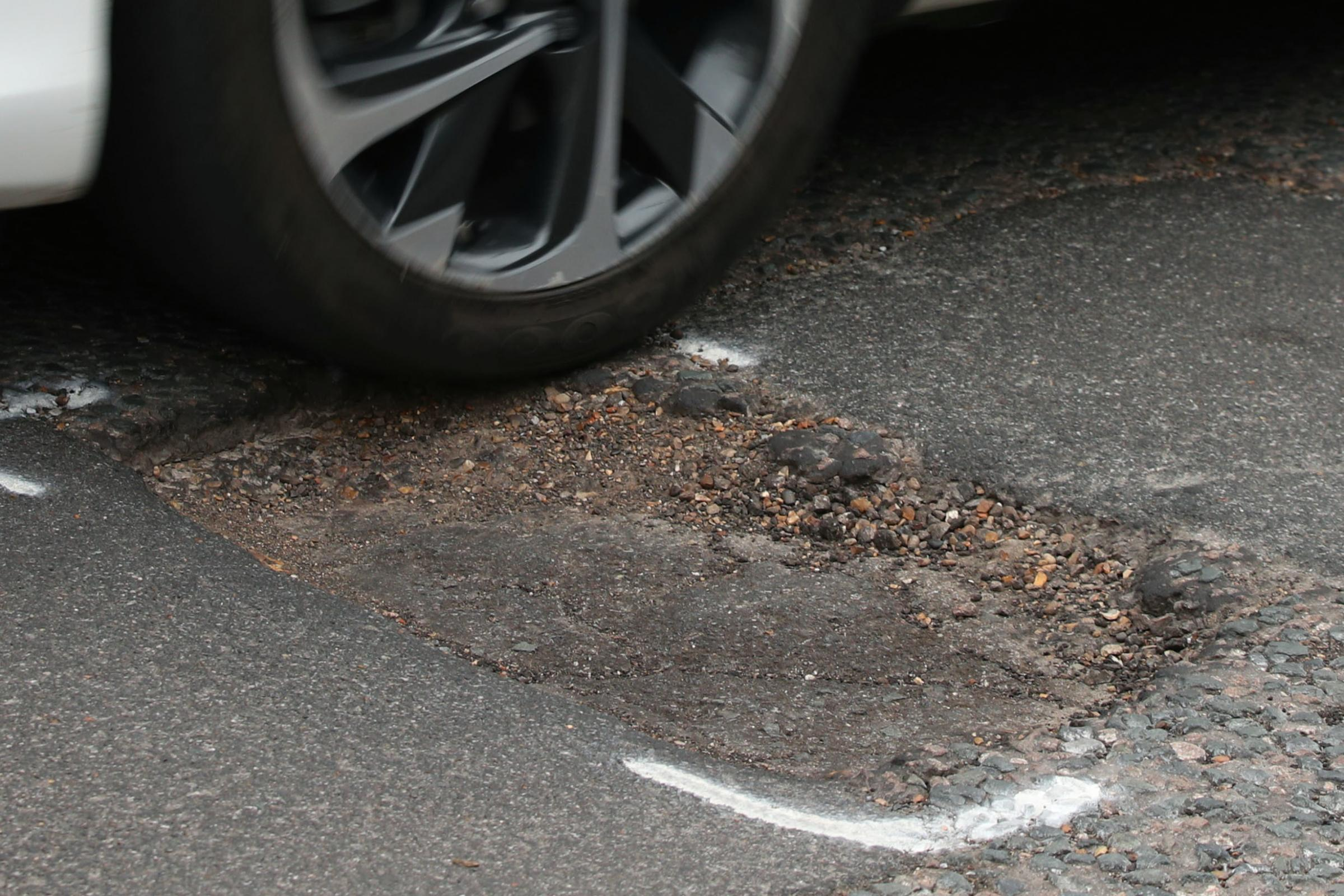 Damaged shock absorbers, broken suspension springs and distorted wheels are among the most common vehicle problems caused by potholes (Yui Mok/PA)