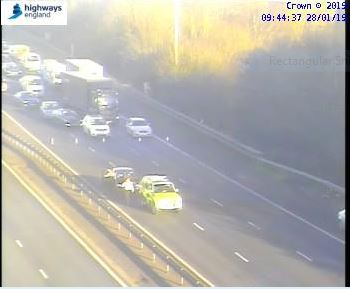 Emergency services at the scene of the M40 collision. Pic: Highways England traffic camera