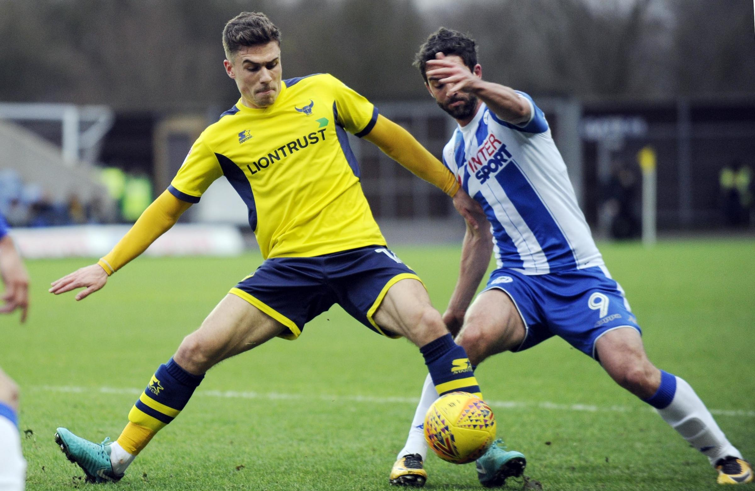 Will Grigg (right) in action against Oxford United last season, where he scored four times for Wigan Athletic   Picture: David Fleming