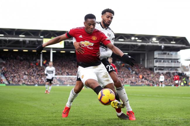 Anthony Martial (left) and Fulham's Cyrus Christie battle for the ball