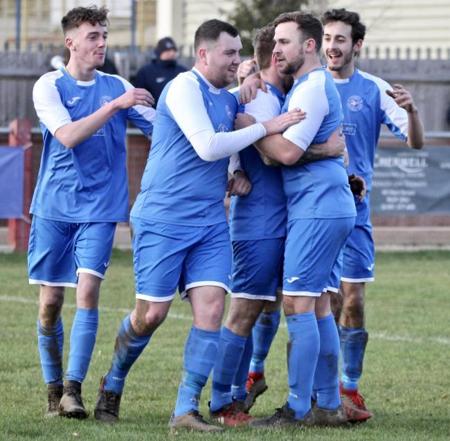 Clanfield striker Jozef Fullerton celebrates with his team mates after extending the lead against Easington Sports  Picture: Paul Gibbens