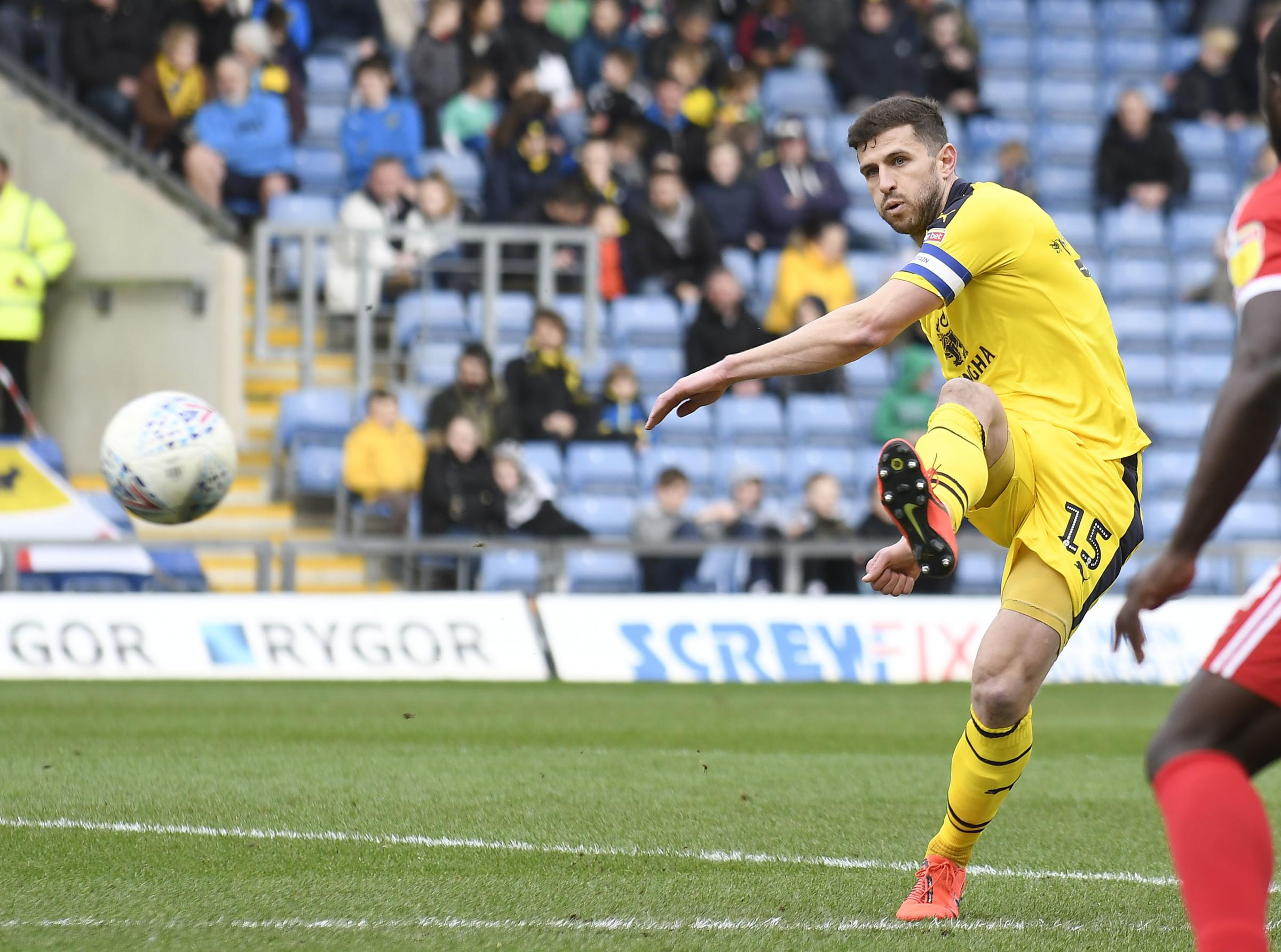 John Mousinho picks out a pass in Oxford United's win against Scunthorpe United – where he set up the winning goal Picture: David Fleming