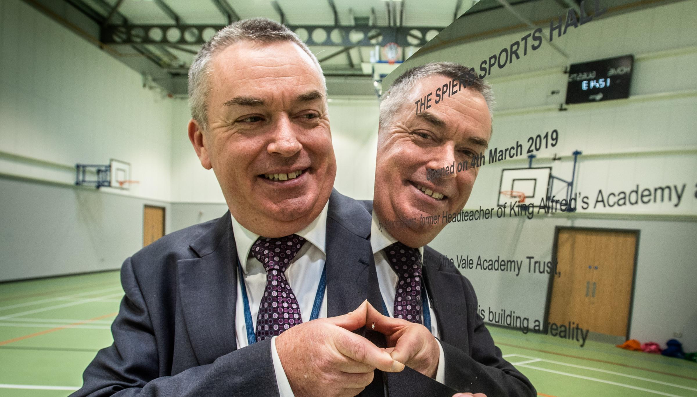Simon Spiers, former King Alfred's head and CEO of Vale Academy Trust, is retiring. Pictured in the school's new sports hall, which has been named after him.