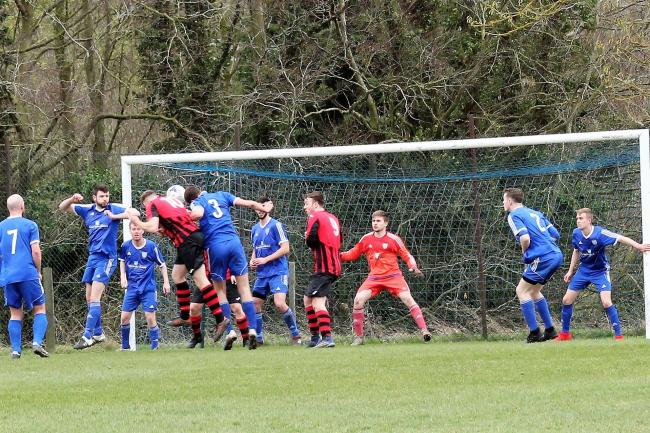 Max Palmer (red) heads Berinsfield's opener against Steventon