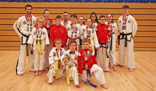 Vale TKD members who starred at the English Championships. From left: Carl Davis, Maisie Bevan, Victoria Davis, Max Rhodes, Harry Bevan, Marin Krachunov, Sami Grimes, Charlie Molloy, Lilly Emptage, Benny Stoten, Natasha Turner, Aisha Macey, Ryan Woodsend,