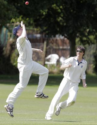 Challow & Childrey's Ollie Dimbylow celebrates catching Nondies' Ian Mead in their Division 2 clash