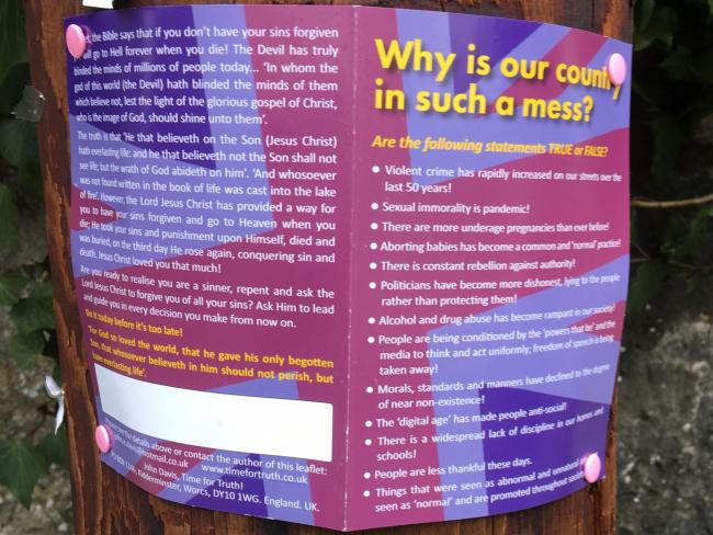 Religious leaflets blasting the 'mess' country is in plastered over town