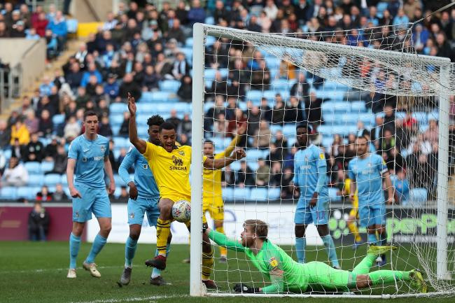 Curtis Nelson forces the ball over the line for Oxford United's winning goal at Coventry City  Picture: James Williamson