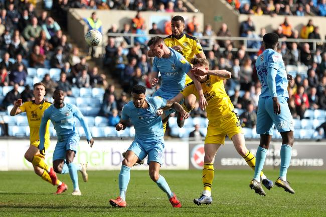 Curtis Nelson rises to meet a corner in the first half in Oxford United's win at Coventry City  Picture: James Williamson