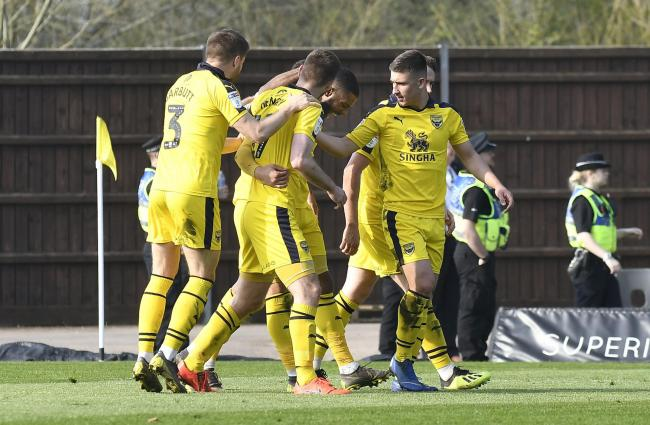 Oxford United's players celebrate their first goal in the win against Wycombe Wanderers last weekend, which took them 12th in the table  Picture: David Fleming