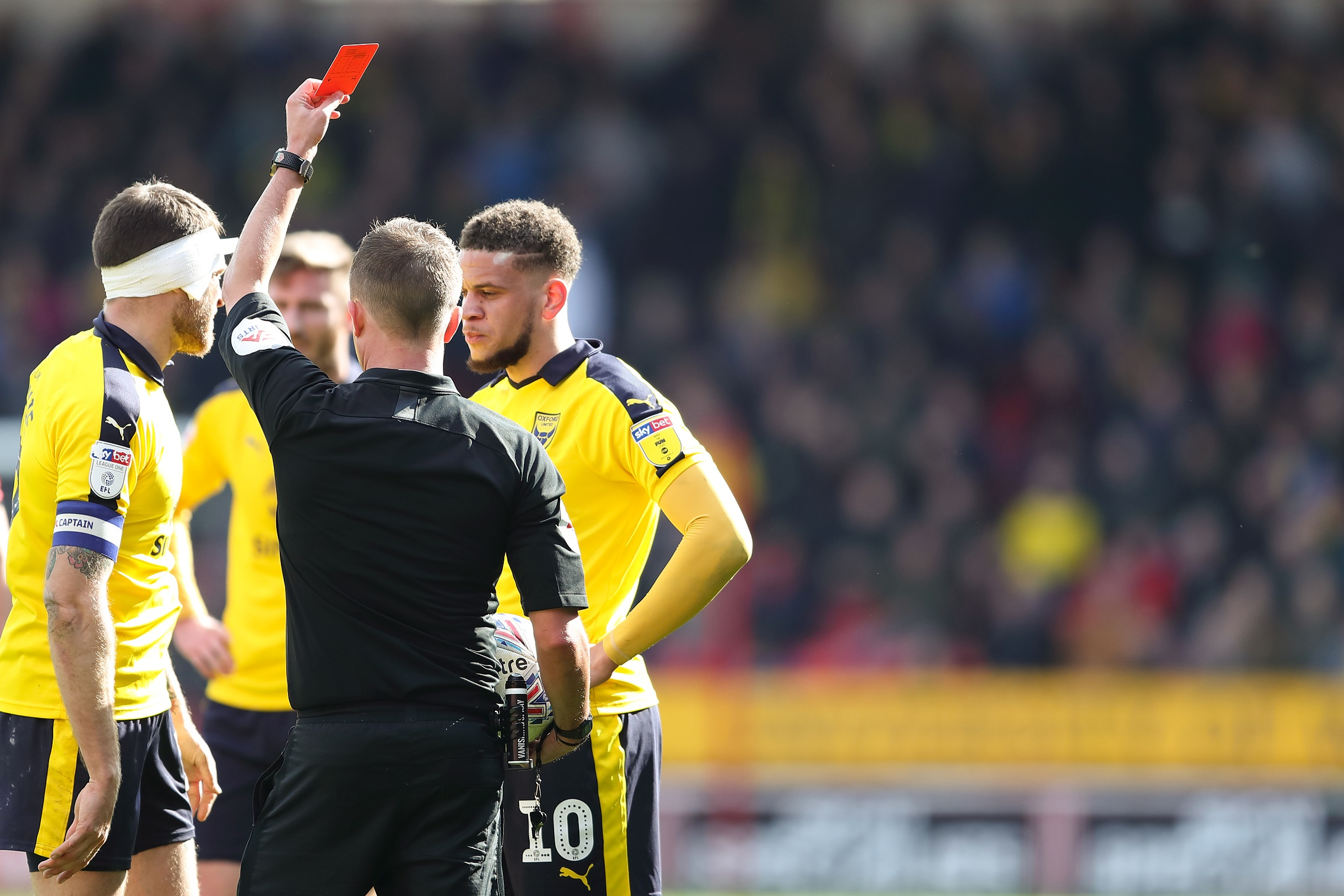 Marcus Browne receives the red card at Walsall from referee David Webb  Picture: James Williamson