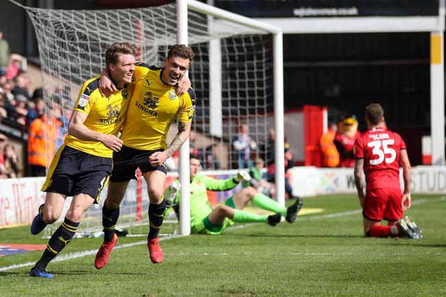 Rob Dickie celebrates with Josh Ruffels after heading Oxford United into the lead against Walsall Picture: James Williamson
