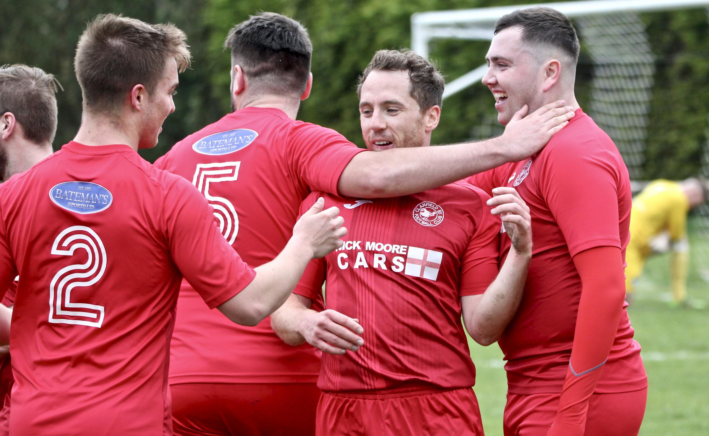 Goalscorer Jordi Mulvany celebrates with his Clanfield teammates after netting against Almondsbury   Picutre: Paul Gibbens