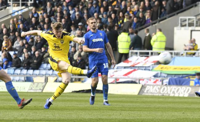 Rob Dickie shoots from long range in Oxford United's goalless draw with AFC Wimbledon  Picture: David Fleming