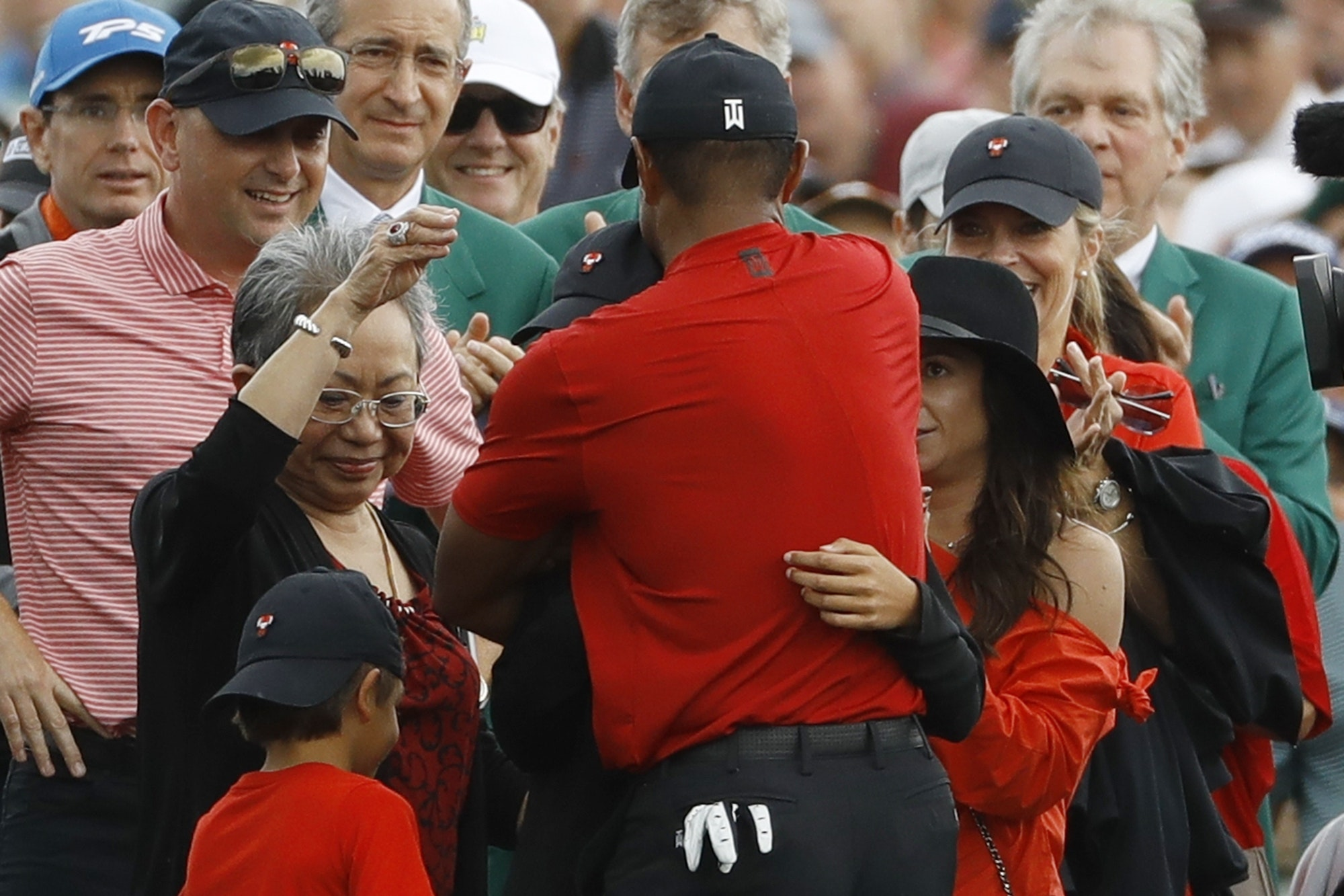 Tiger Woods hugs his family after winning the Masters