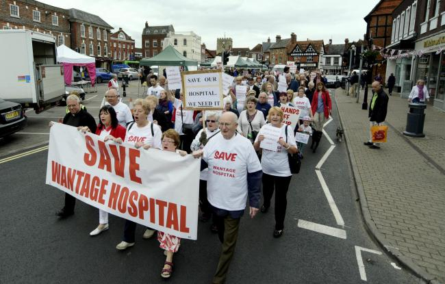 Front L-R, Father John Salter, Cllr Jenny Hannaby (centre), Maggie Swain, Secretary League Friends, June Stock, Chair Grove Parish Council and Derek Verdin, lead a march from Market Place to the Wantage Hospital to appeal against the possible closure of t