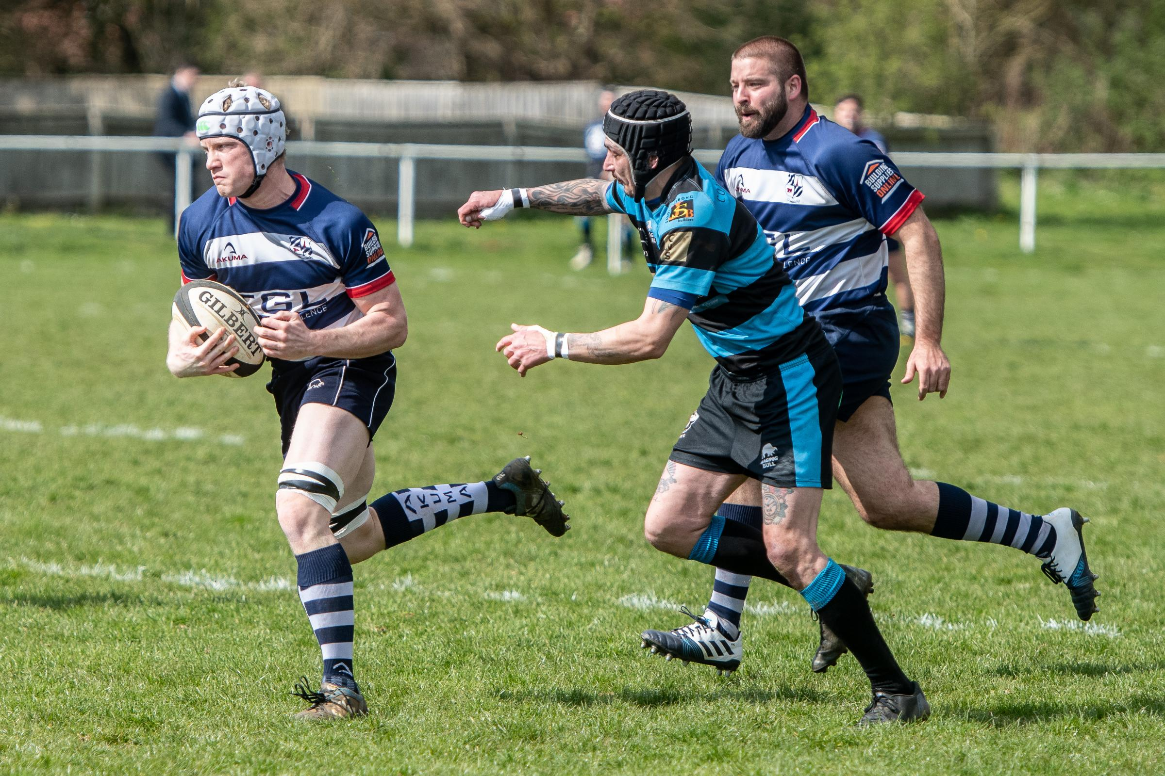 Banbury's Matthew Powell, pictured in action against Witney at the weekend, broke his leg in two places towards the end of the first half Picture: Richard Cave
