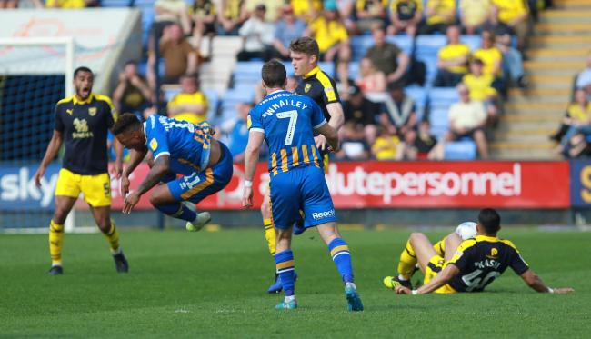 Ahmed Kashi (right) slides in with a challenge which saw Tyrese Campbell sent into the air. The Oxford United midfielder was sent off for the challenge  Picture: Richard Parkes