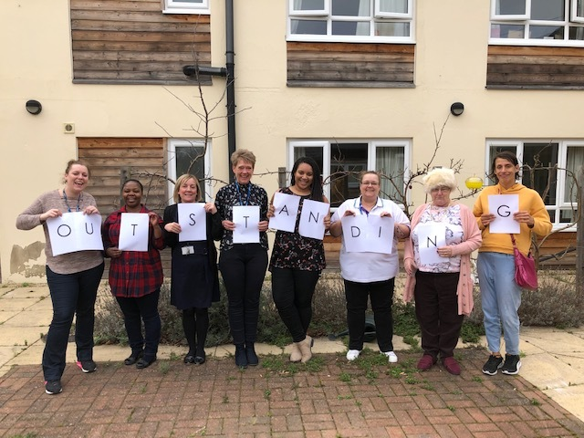 Staff at Orchard House celebrate 'outstanding' CQC rating.