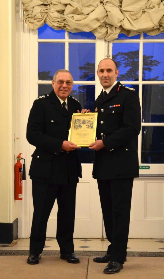 Station manager Pat Rosum receives an honour from chief fire officer Simon Furlong (right). Pic: Oxfordshire County Council