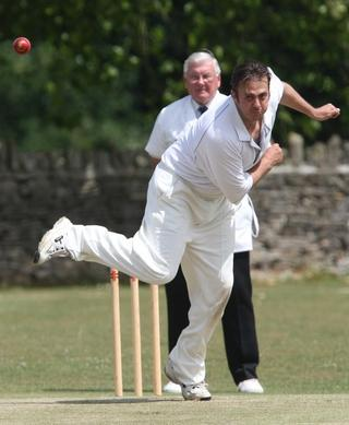 Witney Mills' Jim Skelson bowls against Kingston Bagpuize in their Division 3 draw