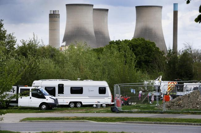 Travellers on the junction of Sir Frank Williams Avenue and the A4130 in Great Western Park, Didcot