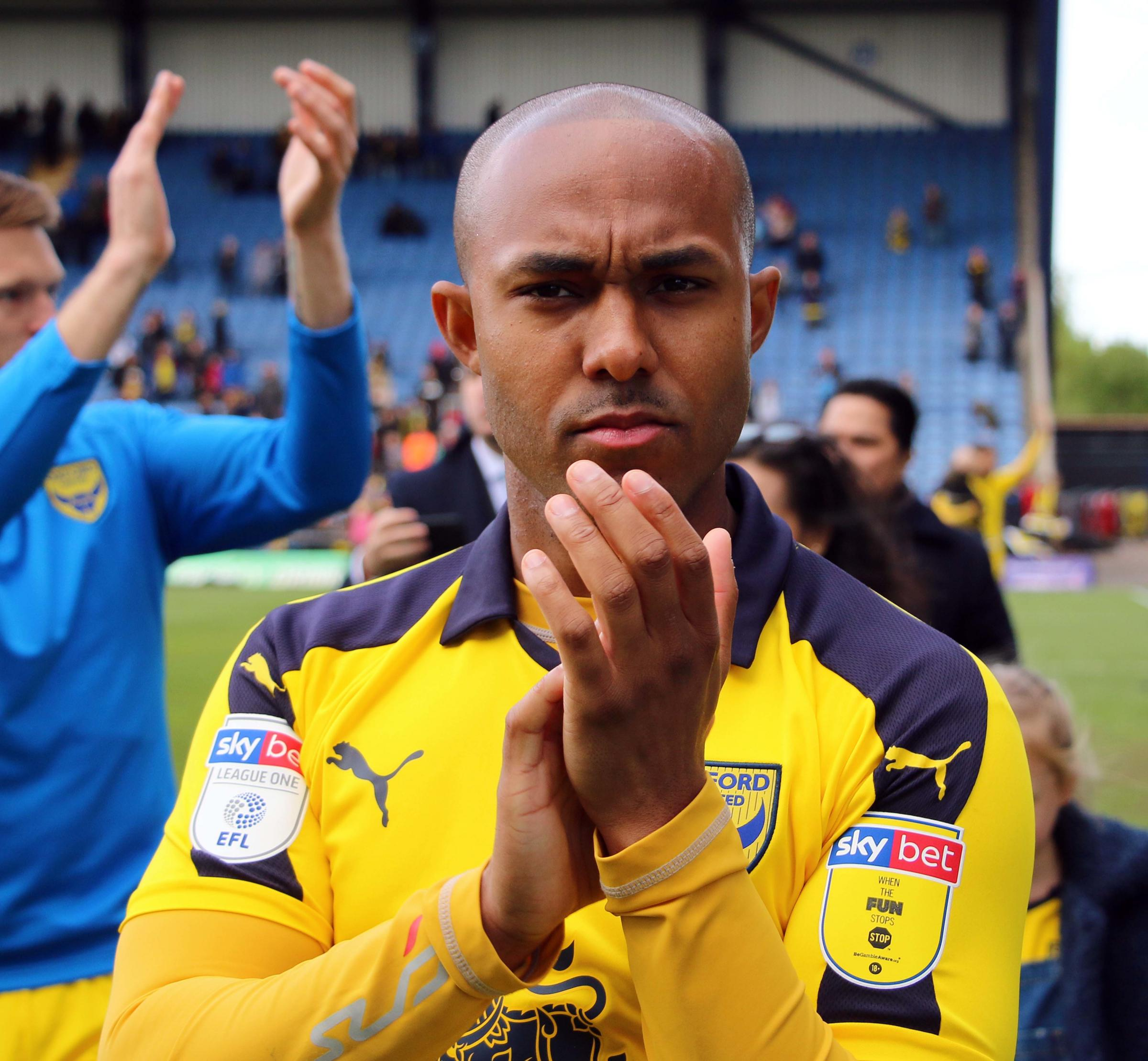 Rob Hall applauds the Oxford United fans after the final whistle on Saturday   Picture: Steve Daniels