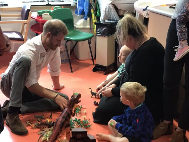 Prince Harry plays 'dinosaurs' with children at Oxford Children's Hospital. Picture@ Naomi Herring/Oxford Mail