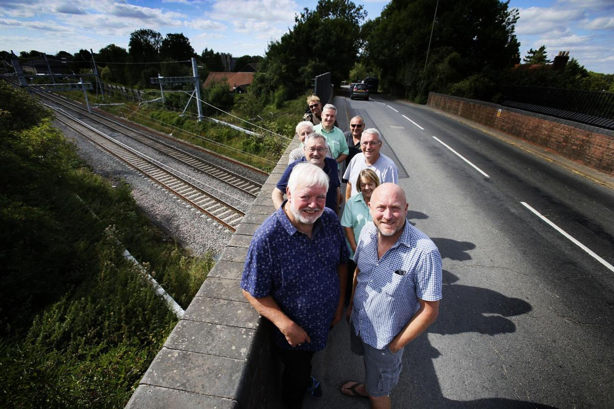 Steventon residents at the railway bridge. At the front is Dr Chris Wilding and Angus Taylor Picture by Ed Nix