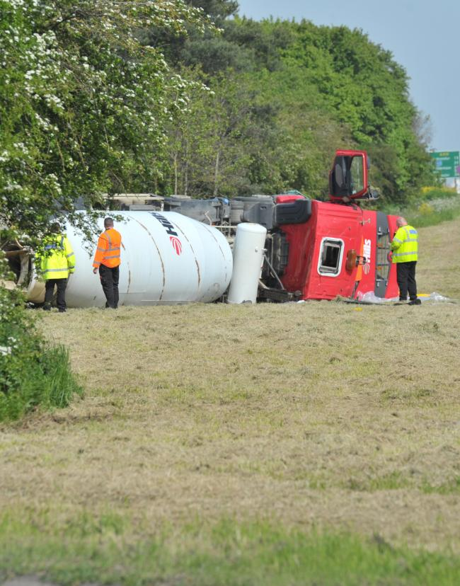 The lorry on its side after the crash. Picture: Dave Cox