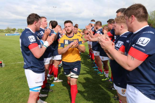 Oxfordshire captain Tom Hall leads his team from the pitch after their defeat to Cumbria Picture: Simon Grieve