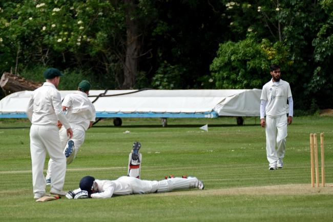 Abingdon Vale batsman Charlie Tomlinson fails to make his ground despite a dive during his side's thrilling clash with Shipton-under-Wychwood Picture: Ric Mellis